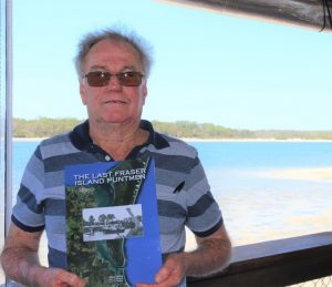 Author of The Last Fraser Island Puntmen, Allan Shillig with his book - the cover was designed by 12-year-old Aiden Obst who also helped with the layout and taught Allan how to edit