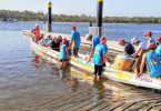 Placement of paddlers in the dragon boat to achieve good balance is crucial overseen by sweep Norma Sanderson.