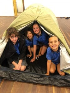 Aaliyah, Sophia, Chloe and Indiana from the Cooloola Coast Girl Guides perfecting their tent skills