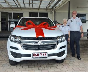 Grants officer Trish Parry and Commander John Macfarlane with the new Coast Guard vehicle purchased with money from a successful grant