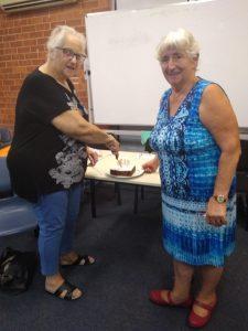 Probus president, Jo Said, with new member, Barbara McKenzie, cutting her 80th birthday cake