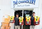 Chris Rippon and Mitchell Cooper from the Chandlery helped supply Sailability with ten new life jackets