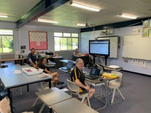 Teachers working together Lynne Chamberlain, Janine Lawler, Tina McColl and Peter Mileson preparing online learning