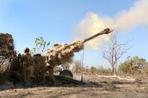 Australian Army soldiers with 8/12 Regiment, fire a M777 Howitzer - photo by Sgt. Sarah Anderson