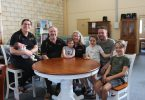 Gympie One Stop Furniture - Owners of the new business, Nicola Garneys with baby Sophie, parents Stephen and Gaenor Garneys with granddaughter Isla, partner Russell Wegner with his sons Nathan and Ashton