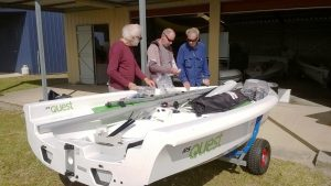 Russell, Mike and Bob of the Tin Can Bay Yacht Club wondering which parts are which and where they go on their new RS Quests