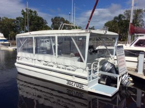 Win a day on this BBQ boat just by buying a $2 raffle ticket from Coastguard!