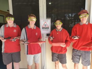 Digital Technology students, Ethan, Blake, Chloe and Jackson with the drones they made at the Tin Can Bay State School