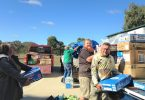 Tony Stewart from Droughtrunners and volunteers unloading donations to Mitchell last month