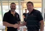 Shane Handy being congratulated by life member Kim McCarthy at the surf club AGM last month after receiving his Life Membership