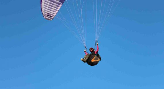 Hang gliders are a regular sight at Rainbow Beach - maybe it's time to give it a try after you learn to dive?