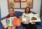 Amanda Geurts and librarian Mrs Sue Dan with some of the books donated by the Geurts family the to Tin Can Bay school library