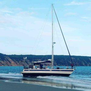 Coastguard recently successfully rescued the yacht stuck on the beach at Double Island Point, Rainbow Beach