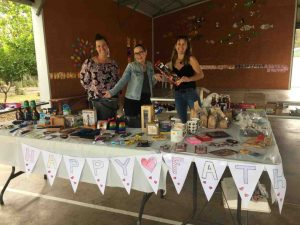 P&C mums, Sandra Lindenberg, Megan Braunberger and Marissa Powers, helping out on the Mother's Day Stall at Rainbow School