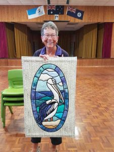One of the new members of Tin Can Bay Quilters, Glenys with her quilt titled Pelican Pete