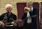 Ron on guitar and Len on harmonica at a Music Plus event pre Covid