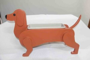 One of the products available for sale from the Men's Shed is Fernando's life size Dachshund planter box