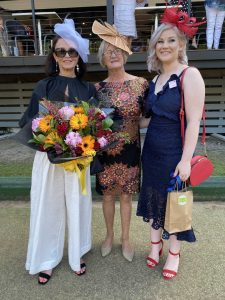 Nelley Matthews from Bribie Island was crowned winner of the Fashions of the Field 2020 at the Rainbow Beach Sports and Rec Club, with elegant Judge Sue Fitzgerald, and Mychaela Kelly from Cooloola Cove was awarded runner up