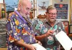 Terry Steele receiving his life membership certificate from TCB RSL President, Don Holland