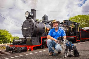 Russell Miller with Detection Dog Maya testing out the 'Pets on Board' service on the Mary Valley Rattler