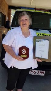 Former president, Lillian Clark, was presented with an award from the Queensland Ambulance Service recognising her 44 years of service