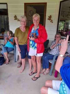 Cooloola Dragon Boat's Head Coach, Sandra Wooster, presents Coach's award trophy to Assistant Coach, Helen Hurworth