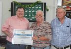 Shed Patron, Llew O'Brien, presenting Shed Manager Bryan Phillips and President Rob Jones, with the certificate through the National Shed Development Program