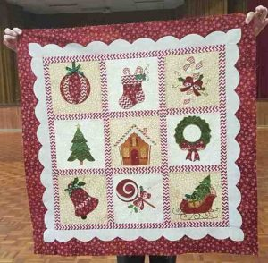 Can you identify this Tin Can Bay quilter who has made this beautiful Christmas quilt?