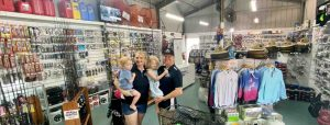 Owner of The Chandlery, Chris and Emma Rippon with their children in the business they have transformed at the Marina, Tin Can Bay