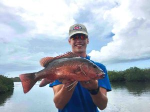 Gardiner Fisheries - Alex Brantz with a Mangrove Jack