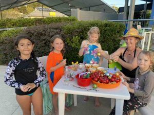 Fun at the Rainbow Beach Aquatic Centre with Maya Dinoia, Frances Hanlon and holiday goers Rebecca Ward with her children Ren and Rata Anderson - there's loads more kid's workshops across the coast and region in January