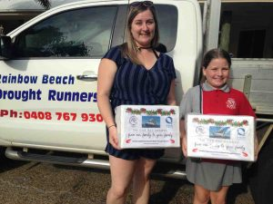 Droughtrunners - Paige and Mia Reibel with a couple of the 40 boxes of prawns donated by Reibels Fishery