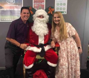 Tin Can Bay Country Club Manager Brad Robb and his wife, Heather, helped Santa Claus this year, and they thank everyone who bought a ticket in the raffle