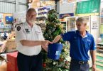 Commander John Macfarlane and Mark from Mitre 10 drawing the Christmas raffle winners for the Tin Can Bay Coastguard