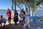 Tin Can Bay Yacht Club - Di and Graham Lee receiving the Handicap award