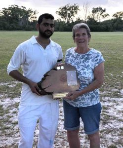 Muhommad Adeel Abid and Edith McBride with the Man of the Match trophy