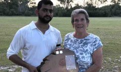 Cricket - Muhommad Adeel Abid and Edith McBride with the Man of the Match trophy