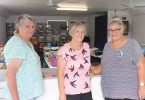 Yvonne, Brenda and Judy sell goods at last month's CWA garage sale