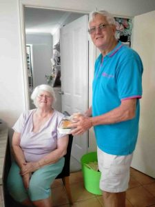 Meals on Wheels volunteer, Don Collins, delivers a meal to client, Delmai Kendal, and invites you to come along and meet the volunteers at Rainbow Beach