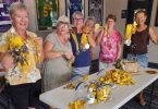 Cooloola Dragons are full of bling at the Queensland Dragon Boat Titles