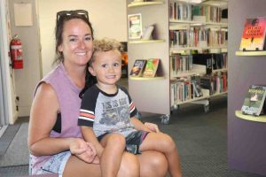 Amanda Schier and son Beau have a cuddle at First Five Forever, Rainbow Beach Library