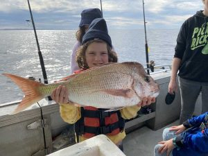 Great catch for 8-year-old Fe - a nice snapper!
