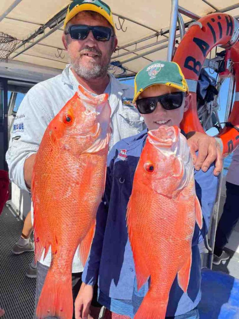 Out of Baitrunner - Dave and son Will with a nice pair of Scarlets to add in their colourful eski while fishing on Baitrunner