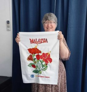 Dianne holds her International Creative Tea Towel Competition entry!