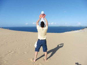 Editor Rhyll's husband, Steve, was delighted to become a father six years ago - here he is celebrating his first ever Father's Day by showing baby Silvie the sand blow