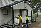 David and Sarah put finishing touches to painting the Tin Can Bay RSL