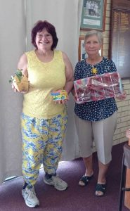 Our lucky hoy winners from Daffodil Day show off their lovely prizes