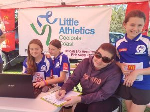 Little Athletics - Renee Burton filling in registrations at the sign-on day at the Tin Can Bay Markets