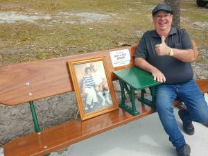 Bronco Jensen on the seat dedicated to his parents, Ron and Eve Jensen