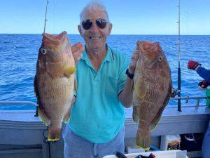Fishing Club President Jim George with two nice maori cod caught a few kilometres off Rainbow Beach